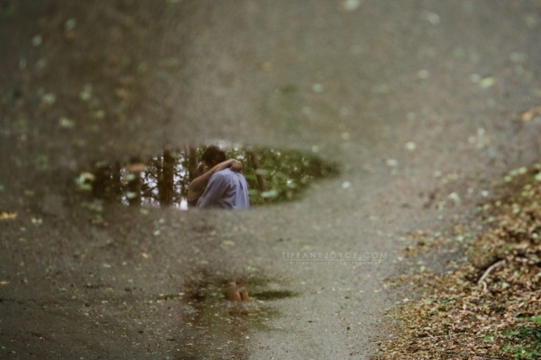 Reflection of couple in puddle during Ledyard engagement session in CT