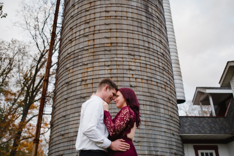 Couple in front of silo at Fox Farm Brewery
